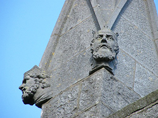 the heads of kings are carved into the pinnacles of the church roof, where only angels, birds, and adventurous photographers can see them